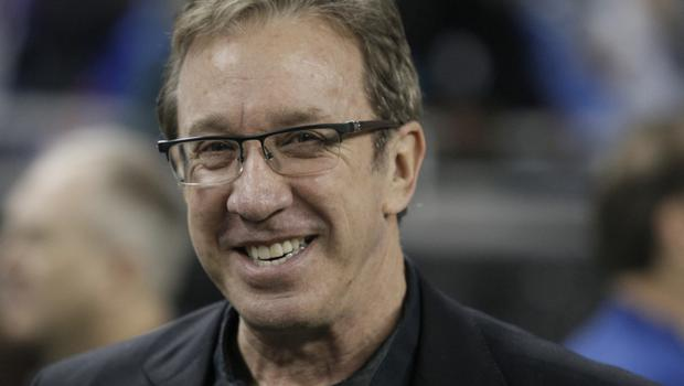 """FILE - In this Nov. 27, 2014, file photo, comedian Tim Allen is seen on the sidelines before the first half of an NFL football game between the Detroit Lions and the Chicago Bears in Detroit. The Anne Frank Center for Mutual Respect is calling on Tim Allen to apologize for comparing the experience of being a conservative in Hollywood to living in Germany in the 1930s during an appearance on ABC's """"Jimmy Kimmel Live"""" on Friday, March 17, 2017. (AP Photo/Duane Burleson, File)"""