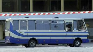 An armed man seized a bus and took people hostage in the city centre of Lutsk (Ukrainian Police Press Office via AP)