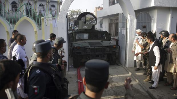 A military vehicle at the mosque in northern Kabul (AP)