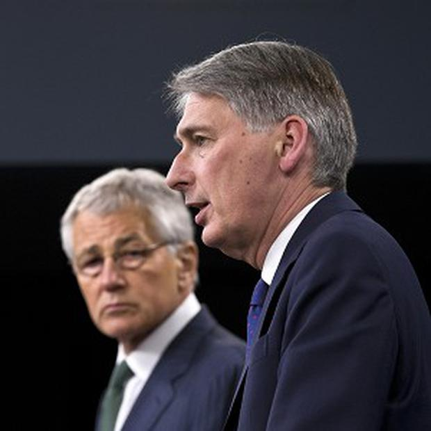 US defence secretary Chuck Hagel listens as UK Defence Secretary Philip Hammond speaks during their joint news conference at the Pentagon (AP)