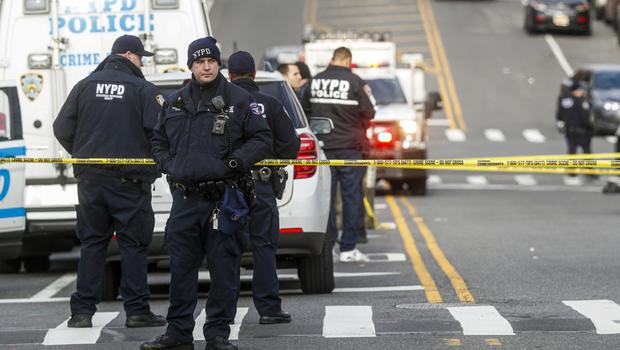 New York City police officers outside the 41st precinct (John Minchillo/AP)