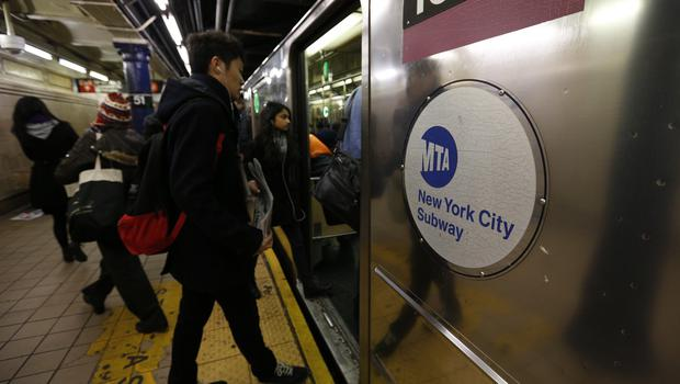 A suspect in an assault on the New York City subway has been shot dead by police