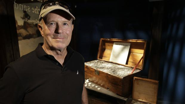 Barry Clifford with a display case containing silver coins recovered from the wreckage of the pirate ship Whydah Gally (AP)