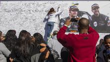 Fans at a memorial rally in California to remember actor Paul Walker and Roger Rodas, who died in a car crash (AP)
