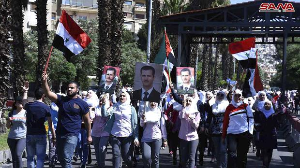 Syrian protesters gather in the captial, Damascus (AP)