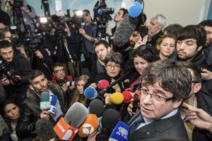 Ousted Catalan leader Carles Puigdemont addresses the media in Brussels (AP)