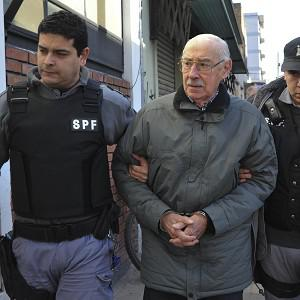 Videla is escorted to a courtroom in Buenos Aires