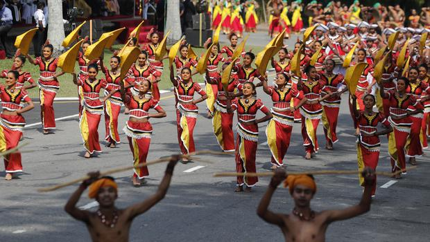 Sri Lankan traditional dancers perform during an event to mark the anniversary of country's independence from British colonial rule (Eranga Jayawardena/AP)