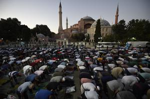 Muslims offer their evening prayers outside Hagia Sophia (Emrah Gurel/AP)