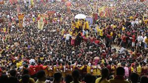 Filipino devotees climb the carriage to touch the image of the Black Nazarene during its annual procession to celebrate its feast day in Manila (AP)