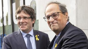 Former Catalan leader Carles Puigdemont with current regional president of Catalonia Quim Torra (Olivier Matthys/AP)