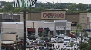 Authorities investigate a shooting in the car park of the Twin Peaks restaurant in Waco, Texas (AP)