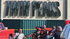 Police investigate the shooting in the car park of Twin Peaks restaurant (AP)
