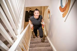 Eva Hall trains at home with bottles of detergent as free weights