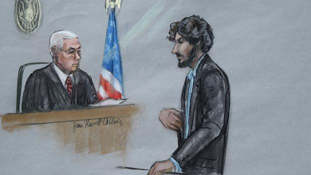 Dzhokhar Tsarnaev, right, stands before US District Judge George O'Toole Jr. as he addresses the court during his sentencing (AP)