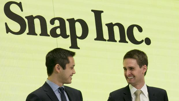 Snapchat co-founders Bobby Murphy, left, and Evan Spiegel ring the opening bell at the New York Stock Exchange as the company celebrates its IPO (AP)