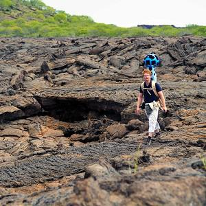 Daniel Orellana of the Charles Darwin Foundation crosses a rocky lava field to collect Street View data (AP/Google)