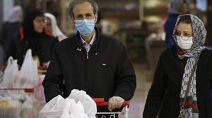 Shoppers wearing face masks and gloves shop at the Palladium Shopping Centre, in northern Tehran, Iran (Vahid Salemi.AP)
