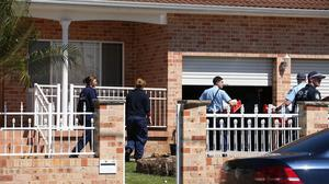 Police investigators work at a home in suburban Sydney after about 800 federal and state police officers raided more than two dozen properties (AP)