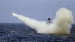 An Iranian warship launches a missile during a naval exercise (AP)