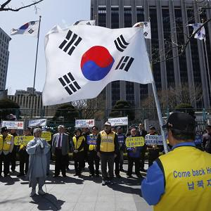South Korean members of the Abductees Family Association hold an anti-North Korea rally in Seoul (AP)