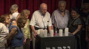 Survivors marked Holocaust Memorial Day at the bombed Jewish community centre in Buenos Aires, boycotting the Argentine government's official ceremony (AP)