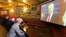 Locals watch the inauguration in Tubridy's Bar. Photo: Eamon Ward