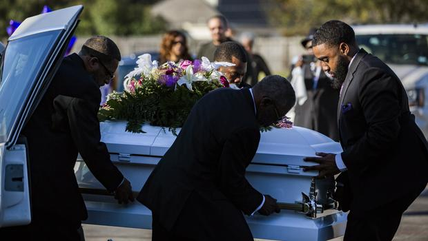 The coffine of Jazmine Barnes is removed from the funeral hearse (Marie De Jesus/AP)