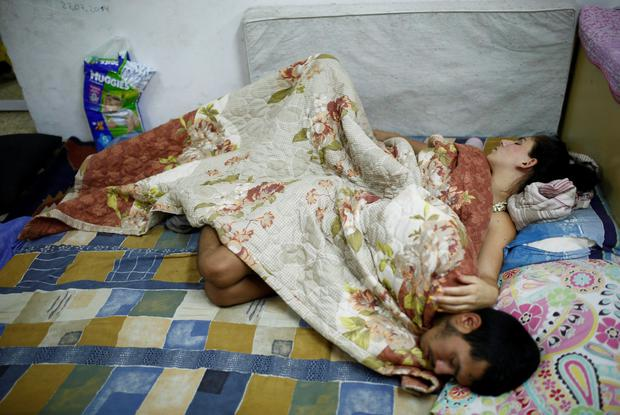 An Israeli couple sleeps in a public bomb shelter in the southern city of Ashkelon. Reuters