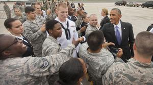 President Barack Obama greets members of the military upon his arrival at MacDill Air Force Base in Florida (AP)