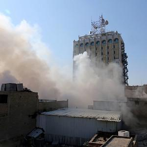 Smoke rises after a parked car bomb went off at a commercial center in Khilani Square in central Baghdad yesterday (AP)