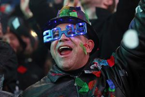 A reveller donned special glasses for the occasion (Adam Hunger/AP)