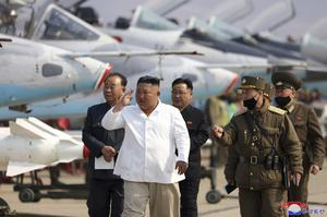 Mr Kim, seen here at an air force defence unit in North Korea earlier this year, was conspicuously absent from a recent celebration honouring his grandfather Kim Il Sung (Korean Central News Agency/Korea News Service/AP)