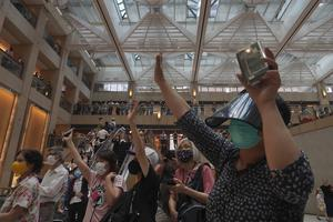 """Protesters gesture with five fingers, signifying the """"Five demands – not one less"""" (VIncent Yu/AP)"""