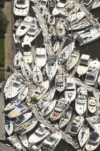 Boats stacked on top of each other in the Southport Marina in North Carolina (Ken Blevins/Wilmington Star-News/AP)