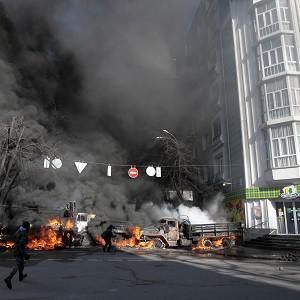 Barricades burn as anti-government protesters clash with riot police in Kiev (AP)