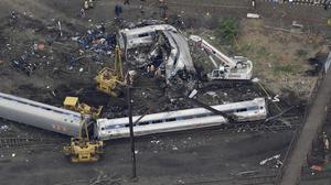 Emergency personnel work at the scene of the deadly train wreck in Philadelphia (AP)