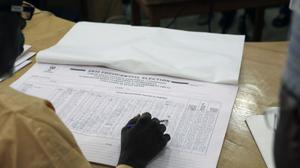 A Nigerian election official reads local results in Kaduna (AP)