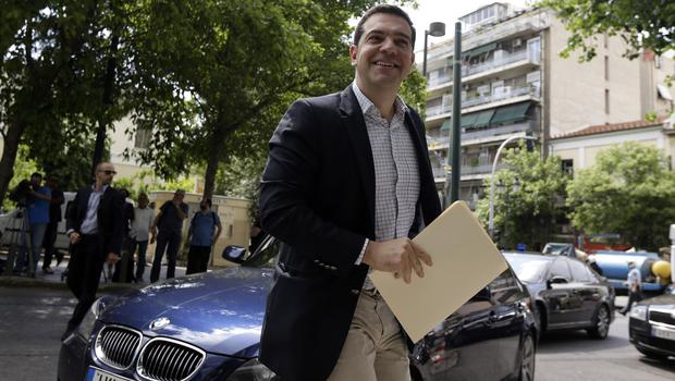 Greece's Prime Minister Alexis Tsipras arrives at Syriza headquarters to brief senior party members about the bailout negotiations in Athens. (AP)