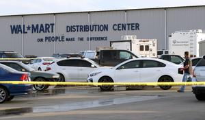 Crime tape blocks off the car park after the shooting outside the Walmart Distribution Centre in Red Bluff, California (Mike Chapman/The Record Searchlight/AP)