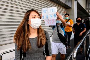 Protests: Student leader Anthea Suen leaves the Eastern District Court in Hong Kong. Photo: AFP