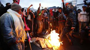Demonstrators burn an effigy of President Rafael Correa to protest against his government in central Quito (AP)
