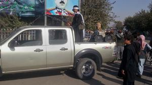 A Taliban fighter stands guard on a vehicle in Kunduz (AP)