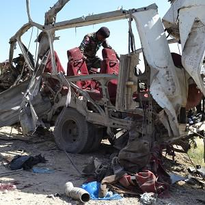 Pakistani security personnel examine a vehicle following the bombing in Quetta (AP)