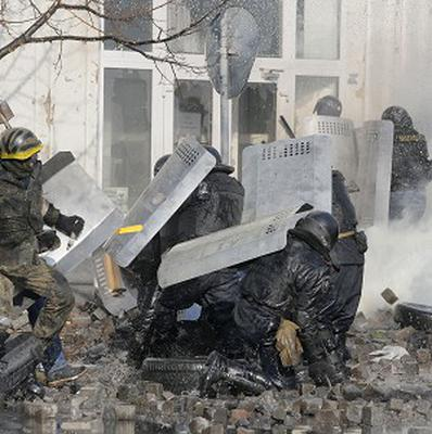 Anti-government protesters clash with riot police outside Ukraine's parliament in Kiev (AP)