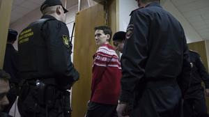 Ukrainian jailed military officer Nadezhda Savchenko, centre, enters a courtroom in Moscow (AP)