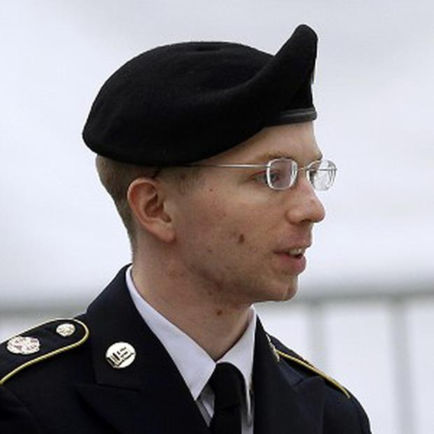Bradley Manning is escorted into the Fort Meade courthouse (AP)