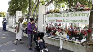 A woman lays flowers outside the Al Noor mosque in Christchurch (Mark Baker/AP)