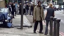One of the suspects talks to cub scout leader Ingrid Loyau-Kennett while holding a knife at the scene of the attack in Woolwich