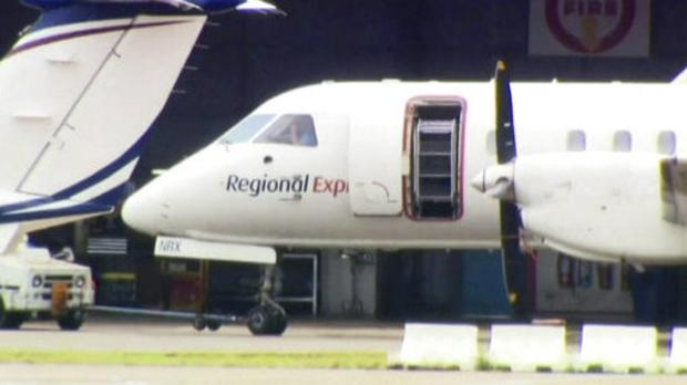 The plane landed safely after one of its two propellers fell off. (Channel 9/AP)